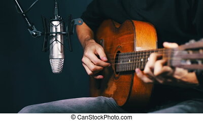 Recording Acoustic Guitar in the Studio. - Man playing...