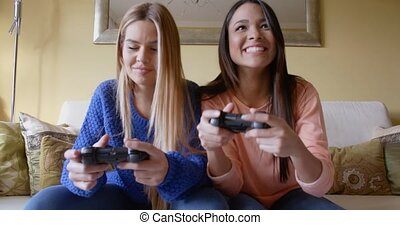 Woman trying to cheat in video game - Upset young woman...