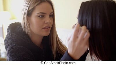Beautiful makeup artist working - Focused beautiful young...