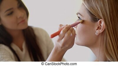 Woman Putting Make up to her Pretty Friend - Kind Young...