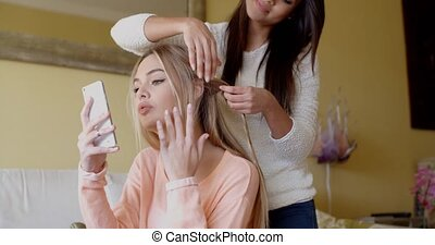 Pretty Woman Fixing Hair of her Best Friend - Kind Pretty...