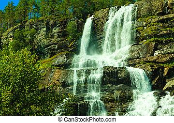 Tvindefossen waterfall near Voss, Norway - Summer mountain...
