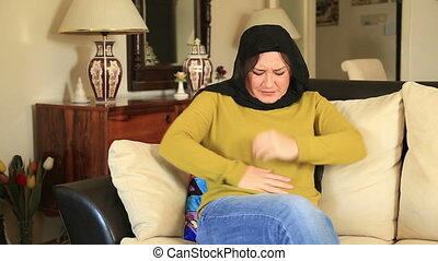 Muslim woman having abdominal pain