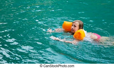 Girl swimming in the lake. - Young girl swimming in the...