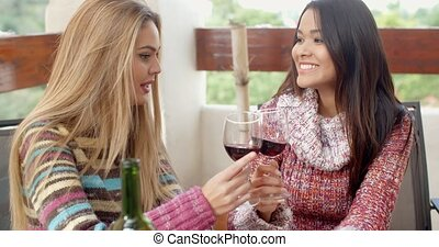 Two Girls Having Glasses of Wine at the Cafe - Two Pretty...