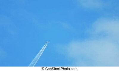 Airplane flying high - Contrails in the blue sky Boeing 737...
