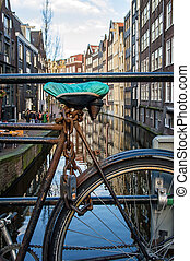 Amsterdan Bicycle Lock - An old fashioned bicycle padlocked...