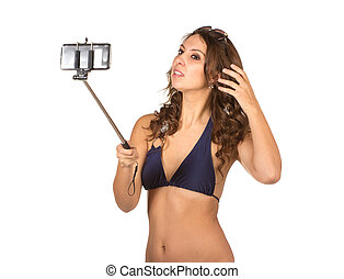 Woman in swimsuits taking a selfie - Close up portrait of...