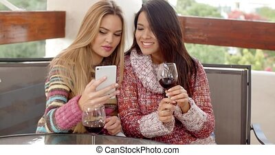 Two Pretty Girls Taking Selfie at the Cafe - Two Pretty...