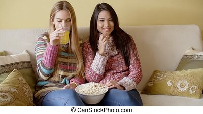 Girls Watching Movie at Home with Snacks - Two Pretty Girls...