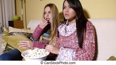 Girls Covering Faces While Watching Horror Movie - Two...