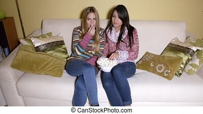 Girls with Bowl of Popcorn Watching Movie at Home - Two...