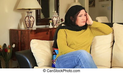 Muslim woman suffering a migraine