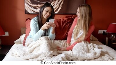 Pretty Girls Chatting in Bedroom Before Sleeping - Two Happy...