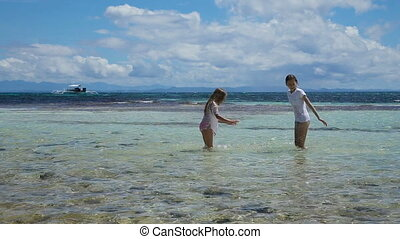 Happy children playing in the sea