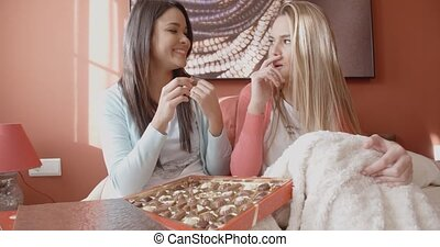 Pretty Girls Eating Chocolates Inside Bedroom - Two Pretty...