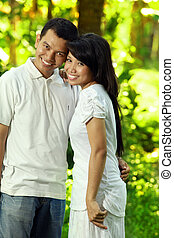 happy asian couple outdoor