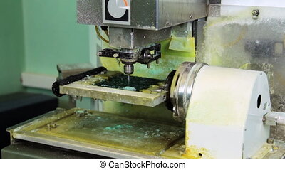 Making copy jewelry of plastic in milling machine Production...