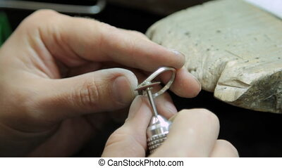 Grinding and polish jewelry gold ring jeweler.