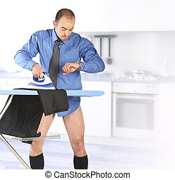 businessman ironing his trouser - businessman late for work...