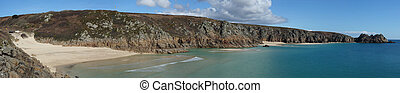 Panoramic view from Porthcurno beach to Logan rock.