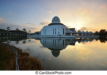 Sunrise over the mosque - Sunrising over the white floating...