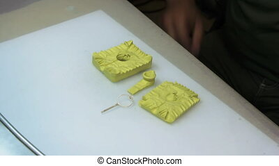Create a form for casting wax copies of jewelry.