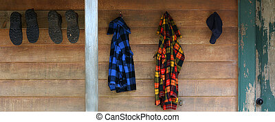 Mountain cabin holiday - Hiking shoes and warm clothes hang...