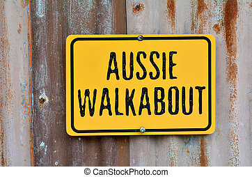 Aussie walkabout sign on an old barn wall