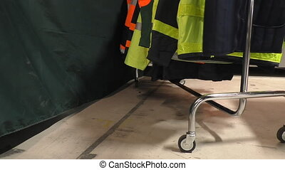 High visibility clothes on rack - Selection of high...