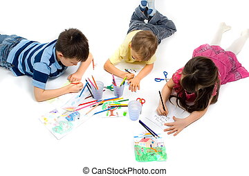 Three Children Drawing on Floor - Three children happily...