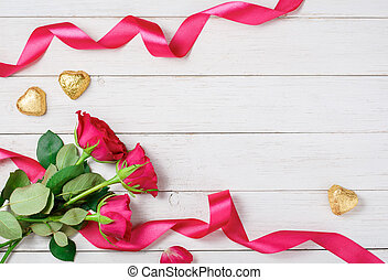 Valentine and 39;s Day background - Red roses, candy on...