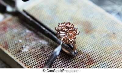 Assembly, soldering pieces of gold jewelry jeweler...