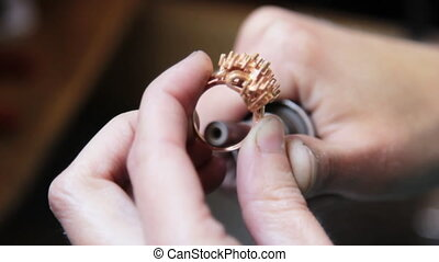 Hand polishing gold jewelry ring jeweler.