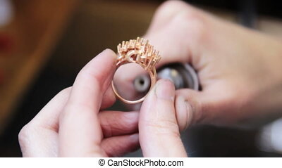 Hand polishing gold jewelry ring jeweler Production and...