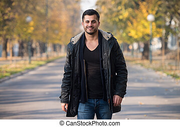 Attractive Man Walking In The Woods - Young Man Walking In...