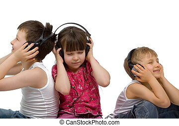 Children Listening To Music - Young girl and her two...