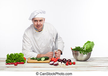 Chef posing with knife in his kitchen - The chef posing with...