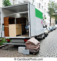 moving house van - moving van with boxes and furniture