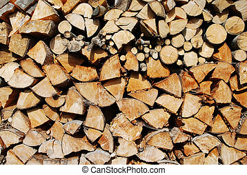 cutted firewood - stacked fire wood forming an interesting...