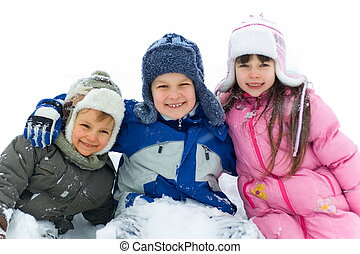 Happy Kids In Snow - Two smiling young brothers and their...