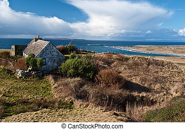scenic irish landscape with old irish cottage by sea - photo...