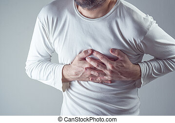 Severe heartache, man suffering from chest pain, having painful cramps