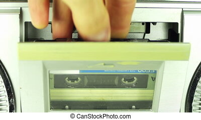 Insert Audio Cassette into the Tape Player - Vintage tape...