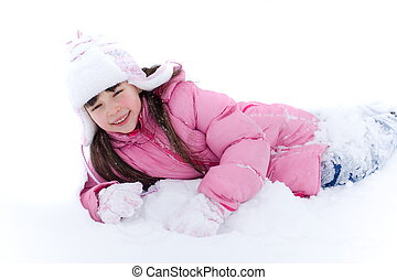 Young Girl In Snow - Smiling young girl laying in snow while...