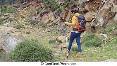 Active fit young woman on a hiking trail