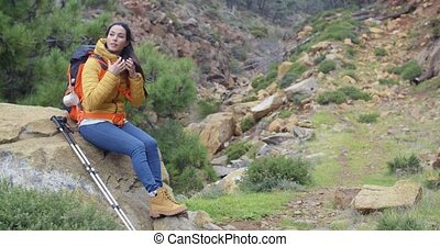 Young backpacker relaxing to enjoy the view - Young woman...