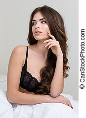 Attractive woman in lingerie looking away - Portrait of a...