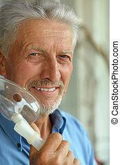 elderly man with flu inhalation - Portrait of elderly man...