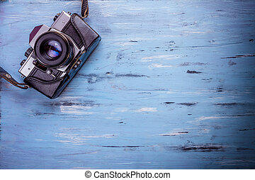 Old retro camera on wooden table background - Old retro...